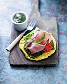 Pizza-style omelette with raw ham and pesto