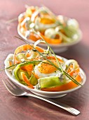 Raw vegetable tagliatelle salad with a soft-boiled egg and yoghurt herb sauce