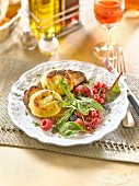 Hot goat's cheese on toast with mixed lettuce and summer fruit salad