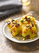 Sweet polenta, raisin, pine nut and pistachio pudding