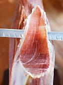 Carving a Serrano ham