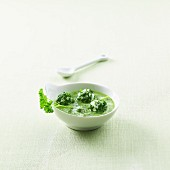 Herb soup with cream cheese and herb balls