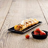 Rolled crepe stuffed with rhubarb and topped with meringue