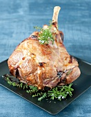 Leg of lamb marinated with thyme and rosemary