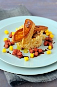 Foie gras escalope,bulghour with dried fruit,mango and watermelon with balsamic sauce