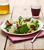 Mixed lettuce salad with meatballs