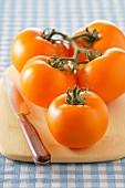 Bunch of orange tomatoes