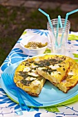 Potato,goat's cheese and cilantro cold omelette with guacamole and sesame seed oil sauce