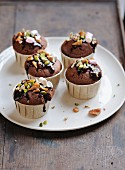 Chocolate, caramel, pistachio and marshmallow cupcakes