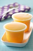 Cups of mango ice cream