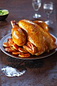Capon cooked with spicy coconut milk and sauteed potatoes
