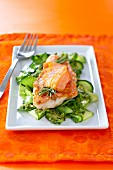 Red mullet fillet topped with salmon, zucchinis with pesto