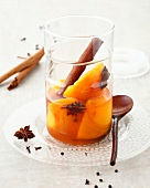 Spicy stewed peaches in syrup