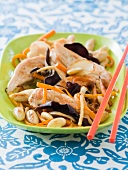 Chicken sauteed with black mushrooms and almonds