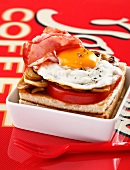 Tomato,fried egg and bacon toasted open sandwich