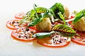 Quinoa and herb balls and tomato carpaccio with tapenade