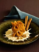 Candied chestnut purse with cinnamon-flavored Raschera cheese sauce