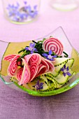 Zucchini and pink beetroot salad with borage flowers