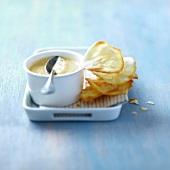 Mango mousse with almond crisps