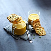 Cream of pumpkin and orange lentil soup,squash seed crisps