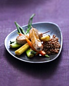 Veal saddle savory brochettes,stewed spelt and glazed mini vegetables