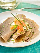 Buckwheat pancakes with seaweed and smoked salmon