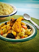 Semolina with chicken, olives, prunes and saffron