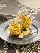 Chicken drumsticks coated in garlic and mustard
