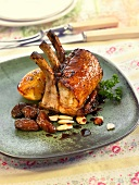 Caramelized loin of pork chops with dried fruit and orange