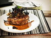 Osso-bucco with artichokes and black trumpet mushrooms