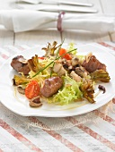 Sausage, squid and fried artichoke salad
