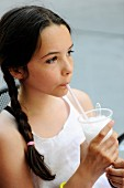Young girl drinking a lemon granita