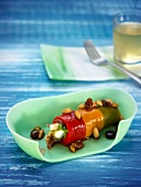 Rolled bell peppers stuffed with dried fruit and cheese