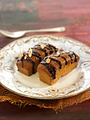 Mini almond cakes with melted chocolate topping