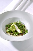 Cod wrapped in lettuce leaves with creamy lentils