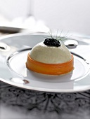Scallop mousse topped with caviar and wrapped in a carrot ribbon