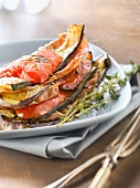 Grilled and layered vegetables and Parma ham