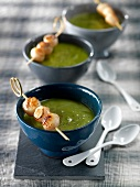 Cream of pea soup with petoncle scallops