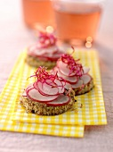 Radishes on sliced brown bread