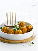 Goose foie gras balls coated in crushed Speculos served with a dip