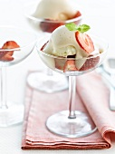 Strawberry fruit salad with beer zabaglione and a scoop of ice cream