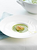 Cream of pea soup with scallops