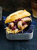 Hot dog with red cabbage and cranberries
