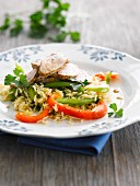 Thinly sliced pork ,basmati rice salad with red and green peppers