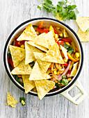 Tortilla crisps with Mexican salad
