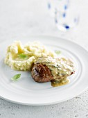 Beef with gorgonzola sauce and mashed potatoes