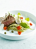 Grilled beef with pasta and pesto