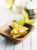 Spicy mexican cheese fondue on tortilla crisps