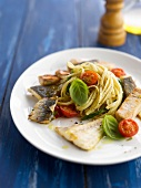 Linguini with fish,cherry tomatoes and basil
