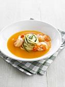 Pumpkin soup with shrimps, tagliatelles and zucchinis